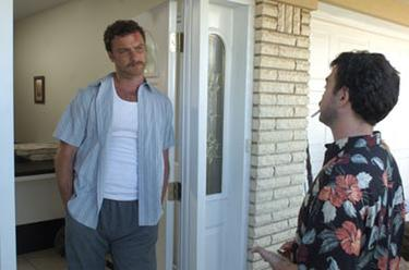 "Liev Schreiber and Joe Lo Truglio in ""The Ten."""