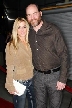 "David Koechner and his guest at the premiere of ""The Hammer."""