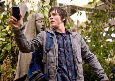 "Percy Jackson (Logan Lerman) uses his PDA to track the deadly Gorgon Medusa - while avoiding Medusa's deadly gaze that turns her victims to stone in ""Percy Jackson & the Olympians: The Lightning Thief."""