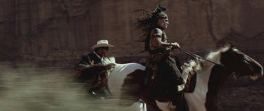 "Armie Hammer as The Lone Ranger and Johnny Depp as Tonto in ""The Lone Ranger."""