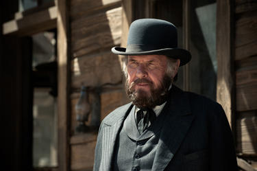 "Tom Wilkinson as Latham Cole in ""The Lone Ranger."""