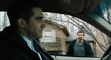 "Jake Gyllenhaal as Detective Loki and Hugh Jackman as Keller Dover in ""Prisoners."""