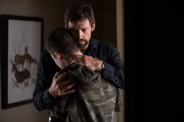 "Dylan Minnette as Ralph Dover and Hugh Jackman as Keller Dover in ""Prisoners."""