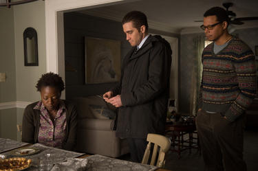 "Viola Davis as Nancy Birch, Jake Gyllenhaal as Detective Loki and Terrence Howard as Franklin Birch in ""Prisoners."""