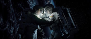 "Sandra Bullock as Ryan Stone and George Clooney as Matt Kowalski in ""Gravity."""