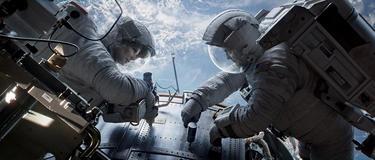 "Sandra Bullock as Dr. Ryan Stone and George Clooney as Matt Kowalsky in ""Gravity."""