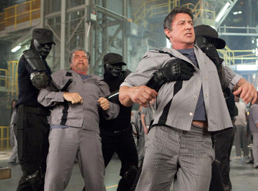 "Arnold Schwarzenegger and Sylvester Stallone in ""Escape Plan."""