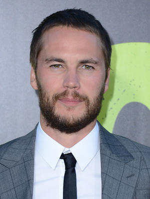 "Taylor Kitsch at the California premiere of ""Savages."""