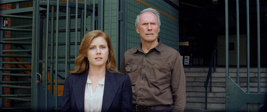Amy Adams as Mickey and Clint Eastwood as Gus in