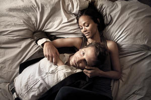 "Bradley Cooper and Zoe Saldana in ""The Words."""