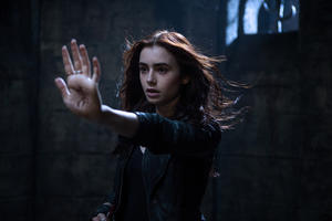"Lily Collins as Clary Fray in ""The Mortal Instruments: City of Bones."""