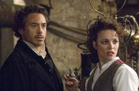 Robert Downey, Jr. as Sherlock Holmes and Rachel McAdams as Irene Adler in