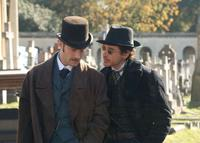 Jude Law as Dr. Watson and Robert Downey Jr. as Sherlock Holmes in