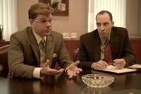 Matt Damon as Mark Whitacre and Tony Hale as James Epstein in