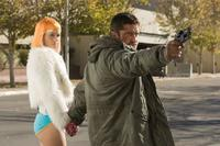 Amber Valetta as Angie and Gerard Butler as Kable in