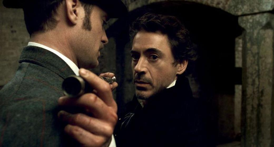 Jude Law as Dr. John Watson and Robert Downey, Jr. as Sherlock Holmes in