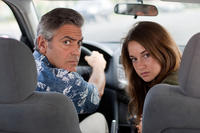 George Clooney as Matt King and Shailene Woodley as Alexandra in