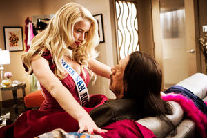 "Amber Heard and Danny Trejo in ""Machete Kills."""