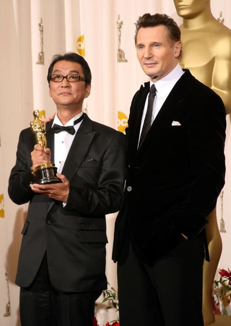Director Yojiro Takita and Liam Neeson at the 81st Annual Academy Awards.