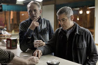 Director Anton Corbijn and George Clooney on the set of