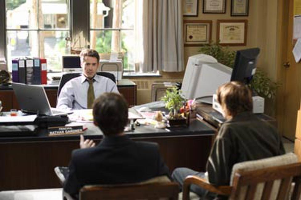 Principal Gardner (Robert Downey Jr.) listens to two students in