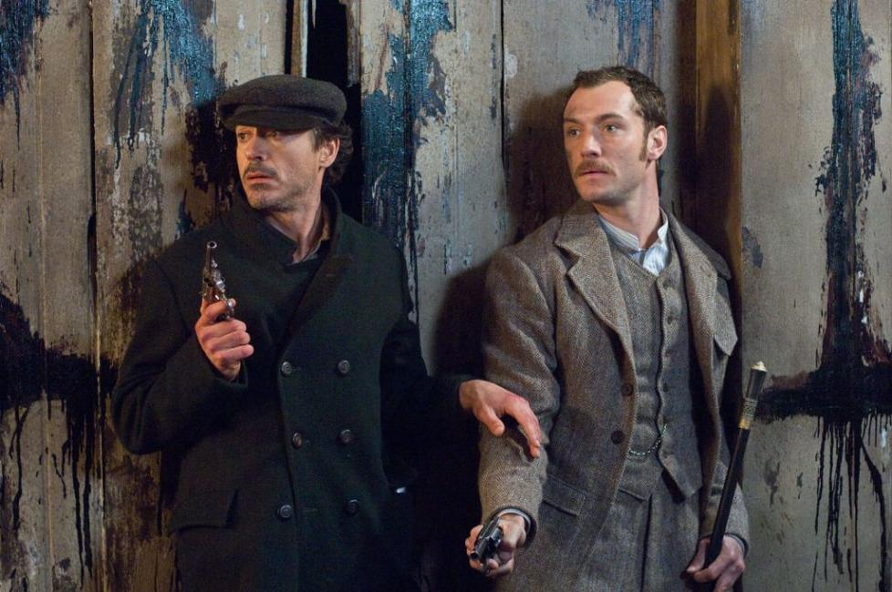 Robert Downey, Jr. as Sherlock Holmes and Jude Law as Dr. Watson in