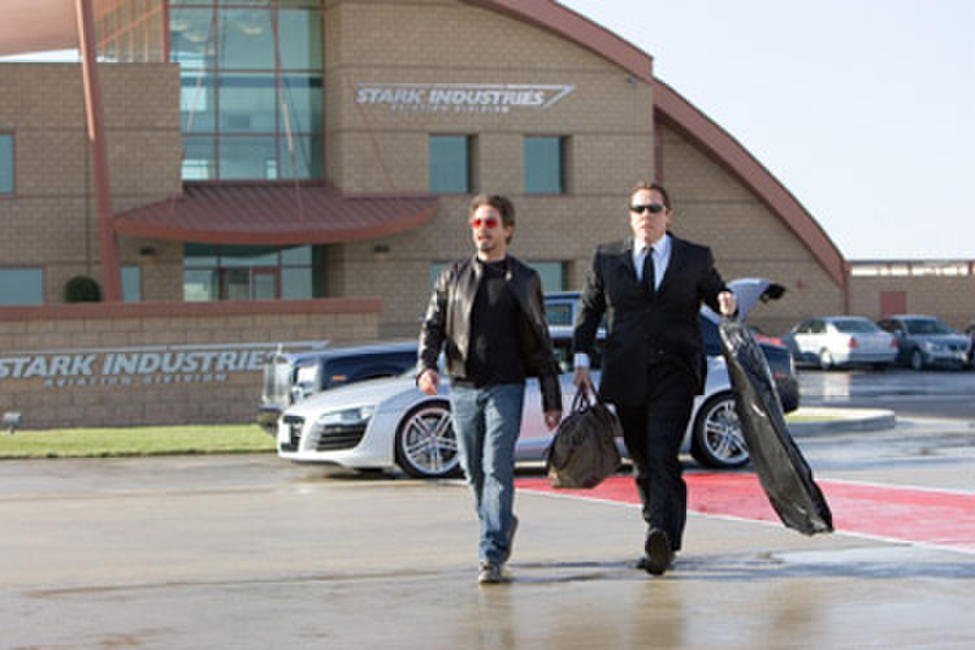 "Billionaire industrialist Tony Stark (Robert Downey Jr.) is attended to by his chauffeur Hogan (Jon Favreau) in ""Iron Man."""