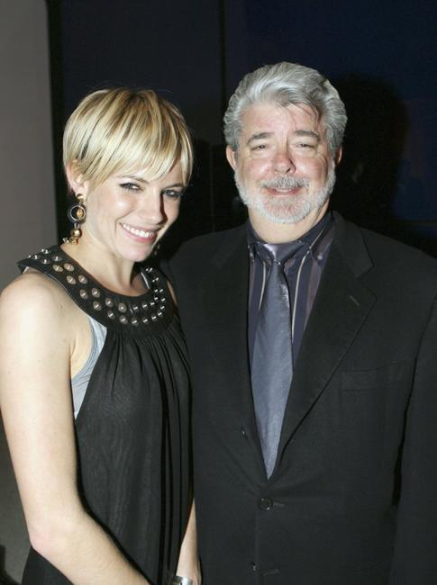 George Lucas and Sienna Miller at the Weinstein Co. Pre-Oscar Party.