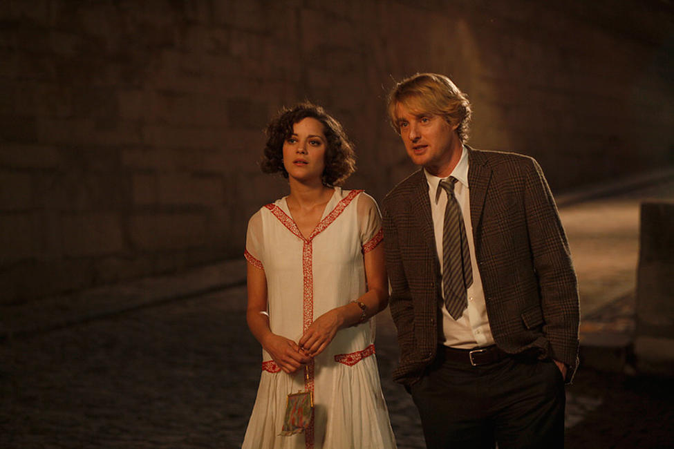 Marion Cotillard as Adriana and Owen Wilson as Gil in