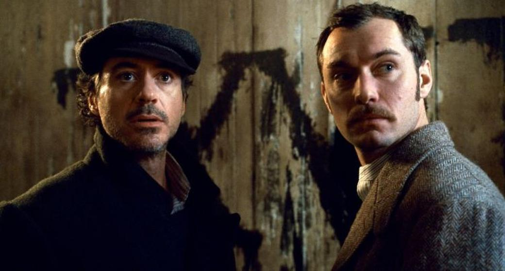 Robert Downey, Jr. as Sherlock Holmes and Jude Law as Dr. John Watson in