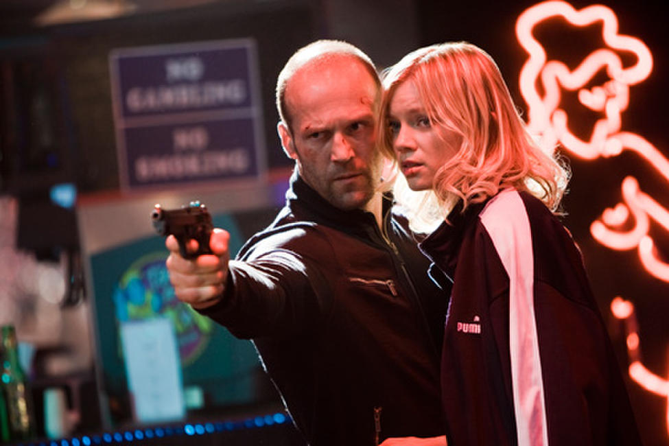 Jason Statham as Chev Chelios and Amy Smart as Eve in