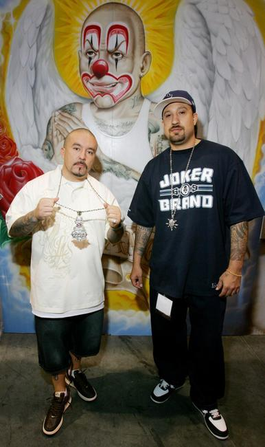 Joker Brand Owner Mr. Cartoon and B-Real at the Joker Brand clothing booth.