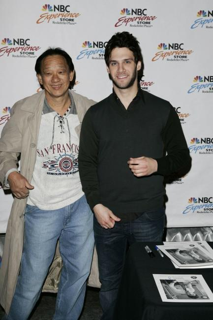 Justin Bartha and fan John Wu at the autograph signing at NBC Experience Store.
