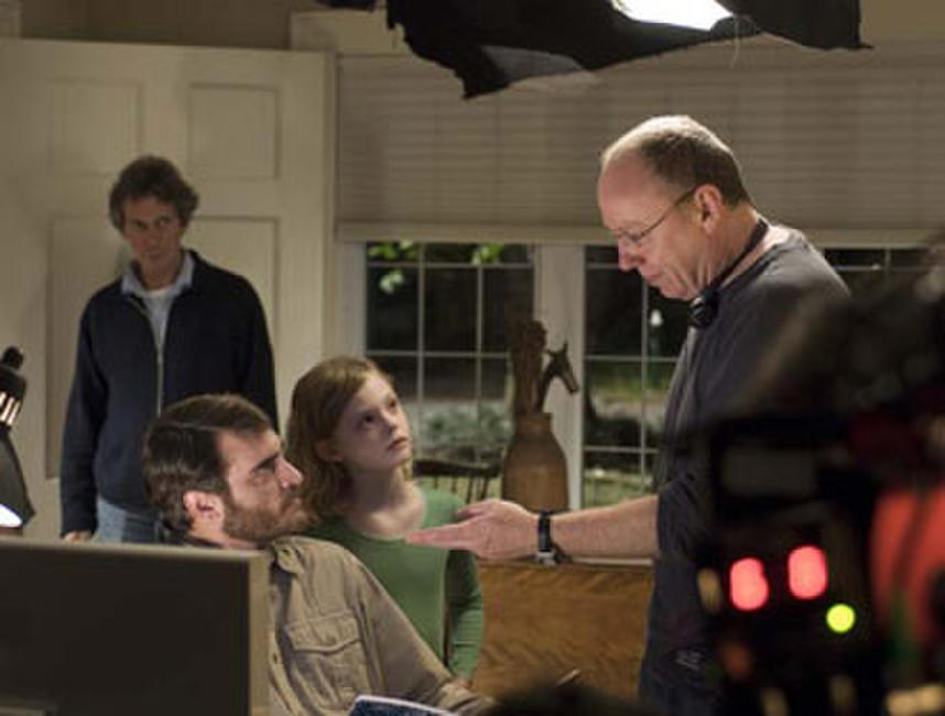 Joaquin Phoenix, Elle Fanning and director Terry George on the set of