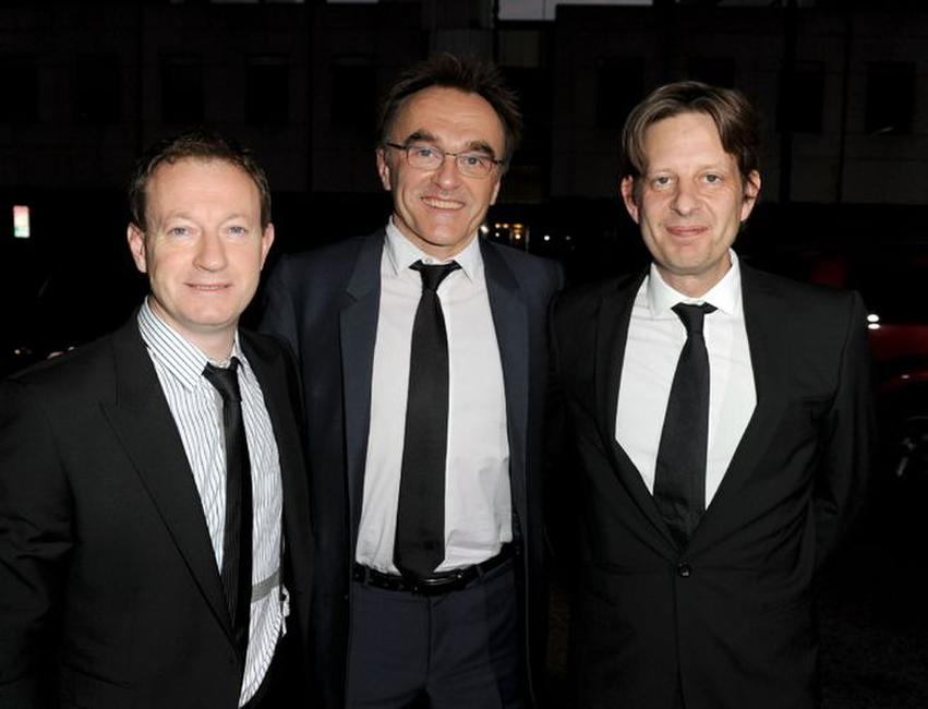 Writer Simon Beaufoy, writer/director/producer Danny Boyle and Christian Colson at the premiere of