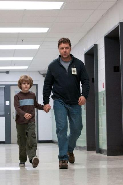 Ty Simpkins as Luke and Russell Crowe as John Brennan in