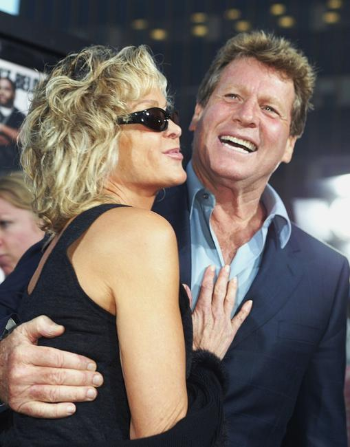 Ryan O'Neal and Farrah Fawcett at the Los Angeles after-party for
