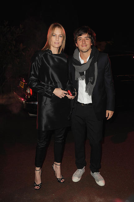 Robin Wright and Guest at the Fashion Dinner for AIDS in Paris.