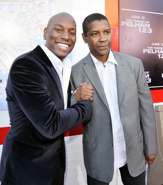Tyrese Gibson and Denzel Washington at the California premiere of