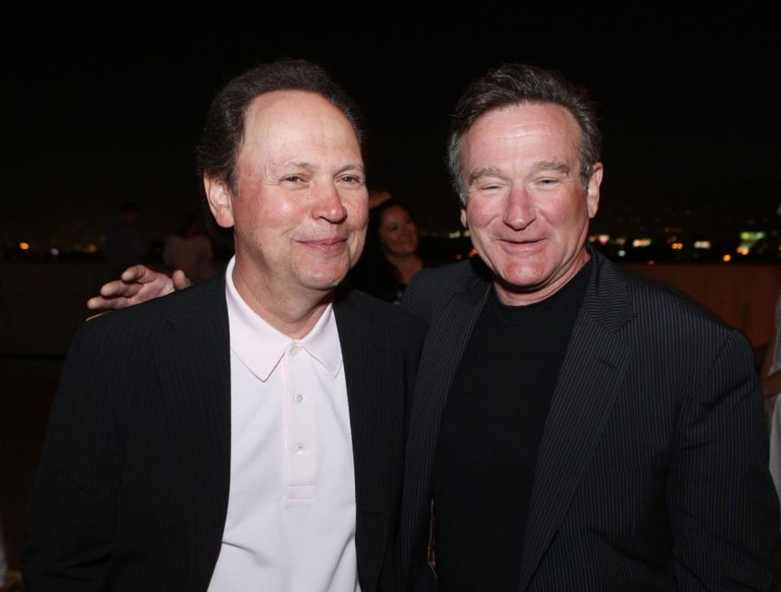 Billy Crystal and Robin Williams at the premiere of Warner Bros. Pictures