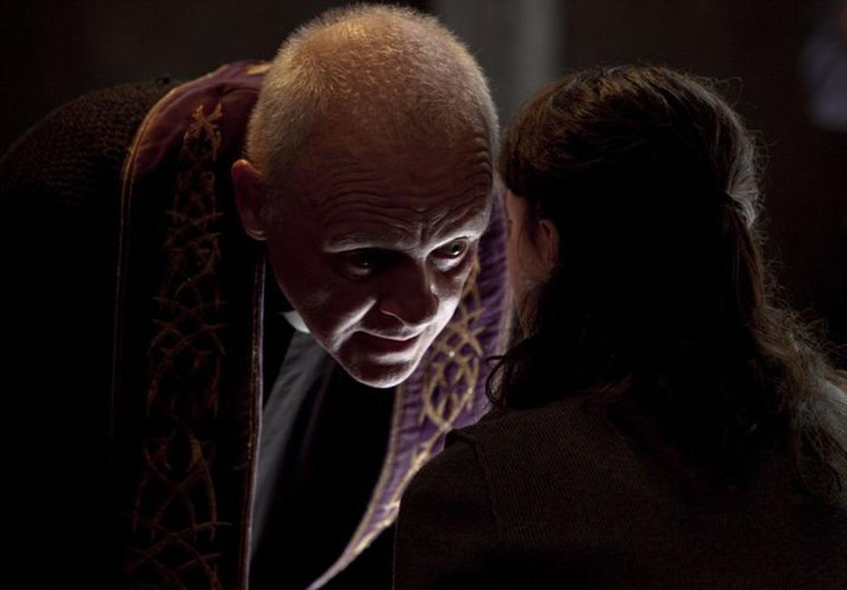 Anthony Hopkins as Father Lucas and Marta Gastini as Rosaria in