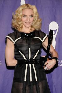 Madonna poses at the 2008 Rock & Roll Hall of Fame Induction ceremony.