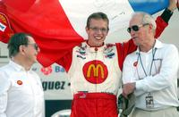 Paul Newman and Sebastian Bourdais with Carl Haas at the Mexico City Grand Prix trophy.