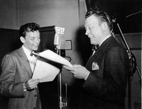Frank Sinatra performs in a broadcast studio.