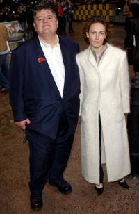 Robbie Coltrane with his companion at the world premiere of