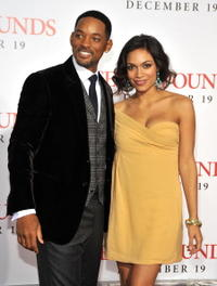 Will Smith and Rosario Dawson at the premiere of