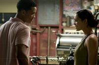 Will Smith and Rosario Dawson in
