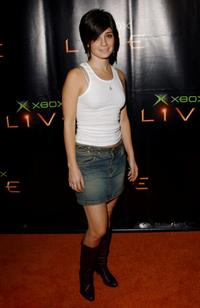 Shiri Appleby at the XBox launches XBox Live an online gaming service.