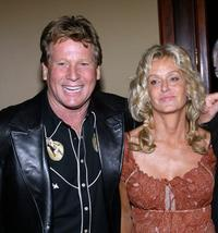 Farrah Fawcett and Ryan O' Neal at the Share Inc. 51st annual boomtown party.