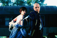Timothy Olyphant and Olga Kurylenko in